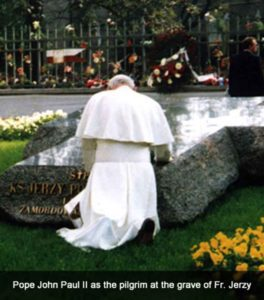 Pope John Paul II praying at the grave of Blessed Jerzy Popieluszko