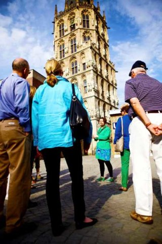 Here a local guide gives a River Cruise group a tour of Cologne, Germany