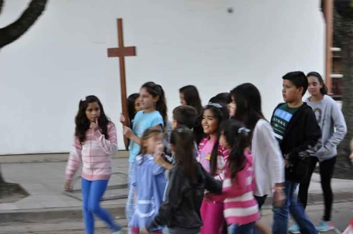 Children processing at the Shrine in San Nicolas