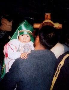 The Feast Day is a family event..here a man brings his young child to the Basilica.