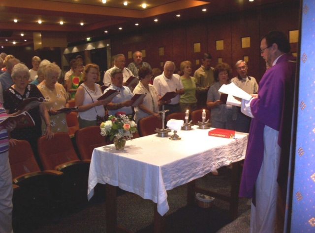Cruise passengers attend Mass while on their cruise