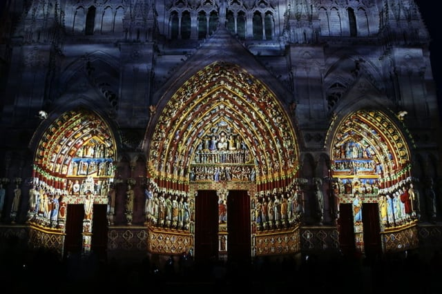 The entrance to Amiens Cathedral at night