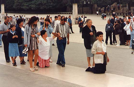Pilgrims crawling on their knees at the Shrine in Fatima