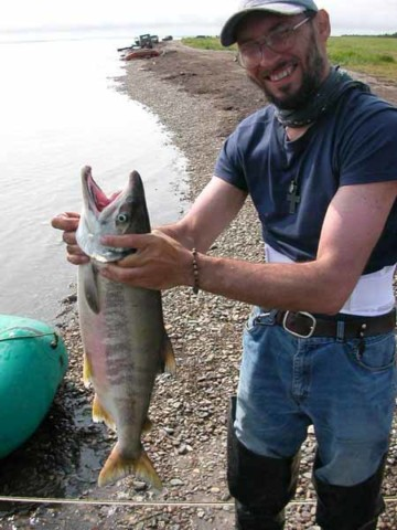Father Milosh with his catch of the day