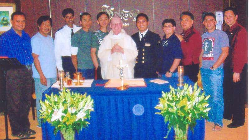 "Fr. Richard McLaughlin celebrating Mass on Holland America's ""Amsterdam"""