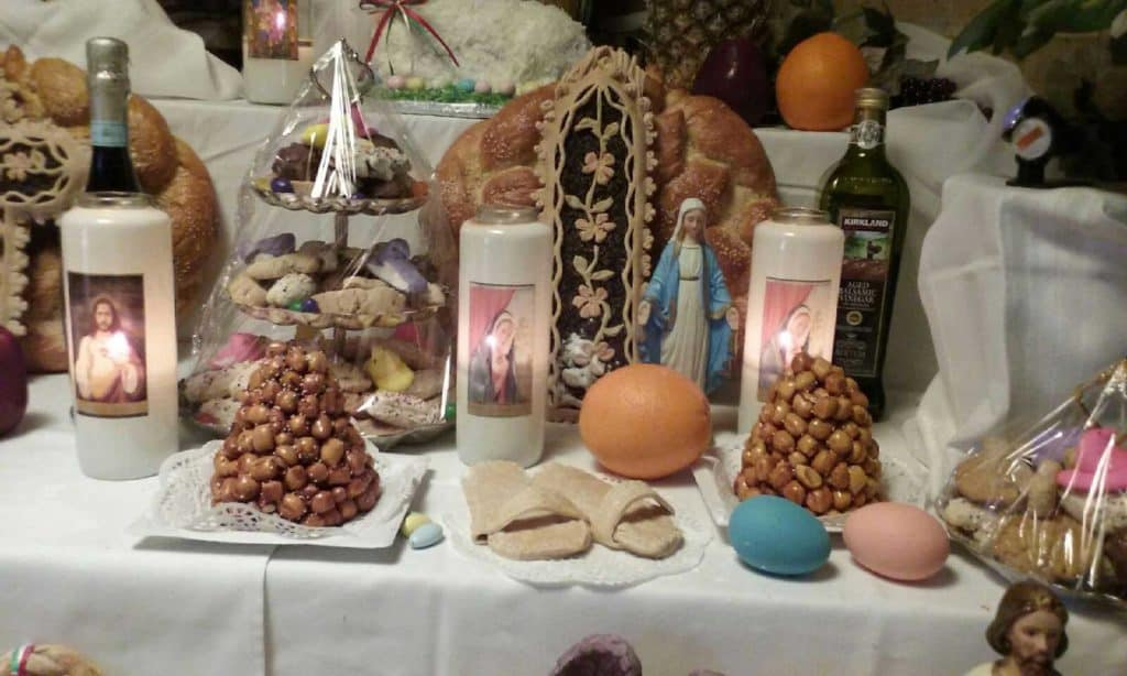 Note the sanadals made from bread dough on Saint Joseph's Table