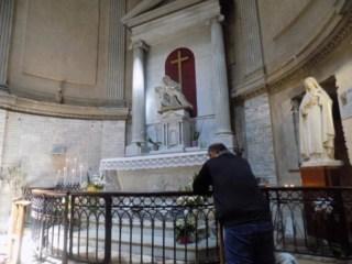 Praying at the Church in L'lle Bouchard