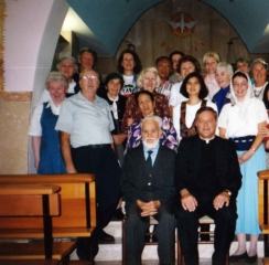 Picture of Bruno (seated) with a group of pilgrims in 1995