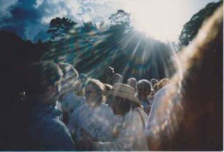 Maria Esperanza (that is her wearing the hat) greeting pilgrims in Betania