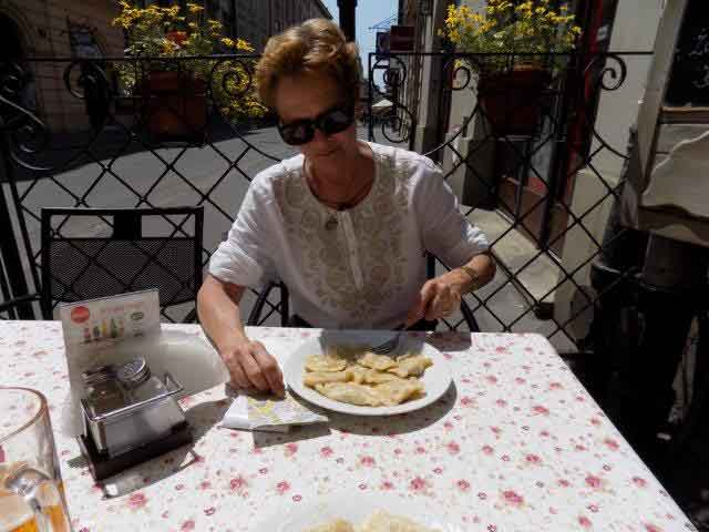Independent travelers get to stop whenever & wherever they want to sample local cuisine...here is an example of eating Pierogies in Poland