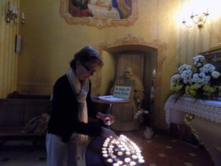 Lighting a candle at the church where St. John Paul II was baptized