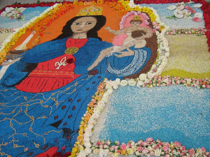 The sidewalks are colorfully decorated for the procession of  Our Lady of Bonaria