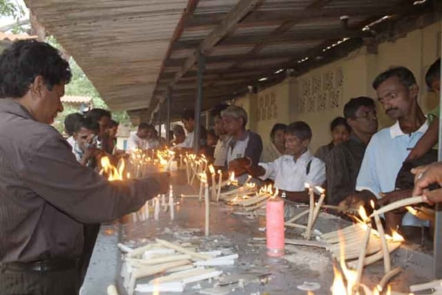 Pilgrims lighting candles at the Madhu Shrine of Our Lady of the Rosary