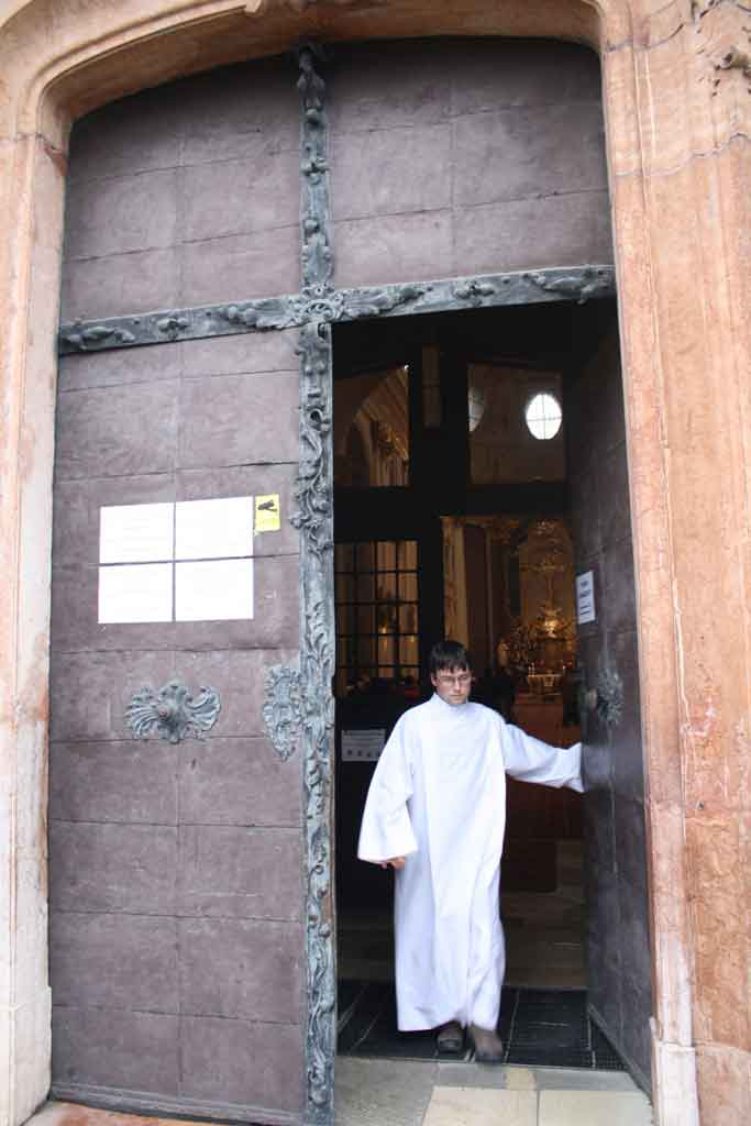 Opening the door at the start of the procession at Our Lady of Sorrows Basilica in Sastin Slovakia