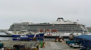 Large cruise ships dock at Lerwick...more than doubling the town's population