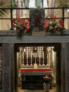 The relics of St. Lawrence under the main altar in the Basilica of St. Lawrence Outside the Walls
