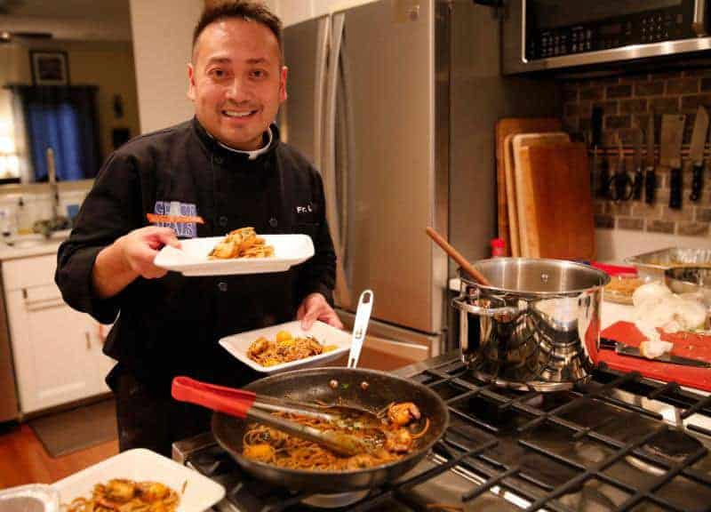 Fr Leo Patalinghug cooking on river cruise from Select International
