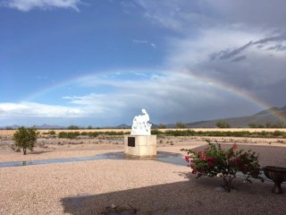 Rainbow over the grounds at Our Lady of Solitude Monastery in Tonopah, Arizona