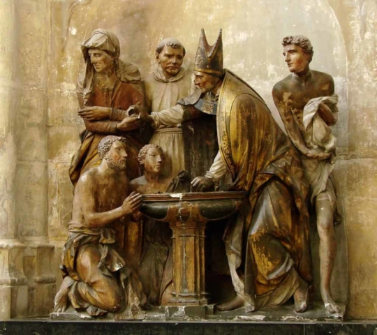 Statue of the baptism of St. Augustine in Troyes Cathedral