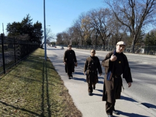 The Knights of the Holy Eucharist walking