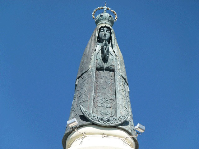 Statue of Our Lady on top of the Basilica of Our Lady of Iatati in Argentina