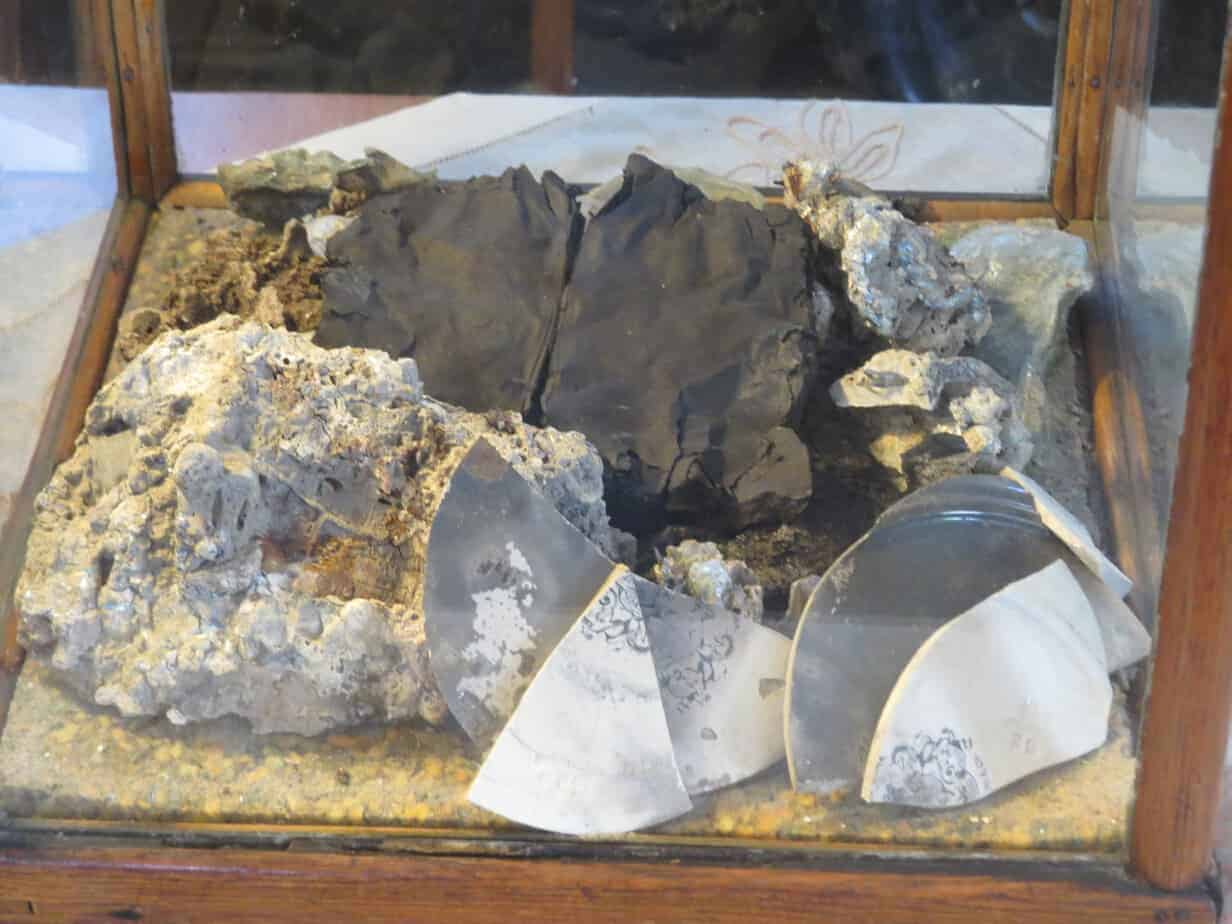 artifacts from the great Peshtigo fire..the blackened object is a bible petrified from the heat